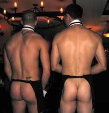 Two male strippers with bottoms showing