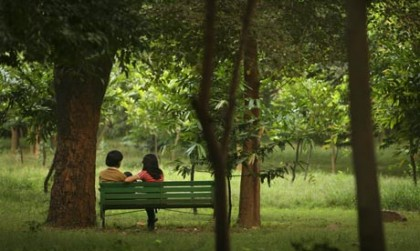 Toyboy flirting with older woman in park