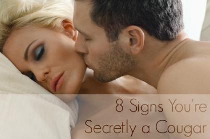 Man kissing on woman's cheek in bedroom